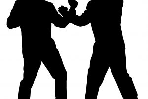 outline of two people fighting